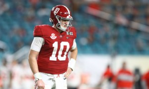 Mac Jones looks toward the Alabama sideline versus Ohio State at 2021 CFP title game