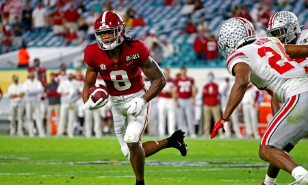 John Metchie runs with the ball against Shaun Wade of Ohio State in CFP title game