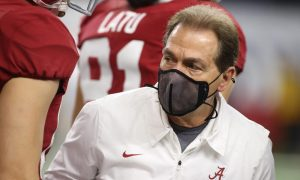 Nick Saban walks through warmups ahead of the Rose Bowl