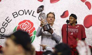 Nick Saban lifts the Rose Bowl trophy