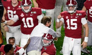 Nick Saban carried onto the field by Landon Dickerson after winning CFP title game