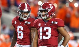 Tua Tagovailoa and DeVonta Smith talk before a play