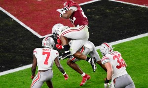 Najee Harris jumps over Ohio State defenders for a touchdown