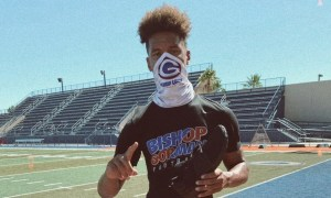 Cyrus Moss poses for picture in Bishop Gorman shirt