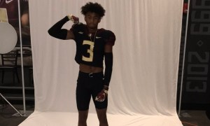 Devin Moore poses for picture with flexed arm