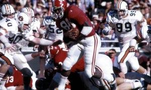 Wilbur Jackson (No. 80) carries the ball for Alabama at running back
