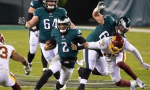 Jalen Hurts runs the ball against Washington Football Team for Philadelphia Eagles