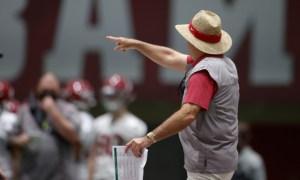 Nick Saban coaching Alabama players on first day of spring practice