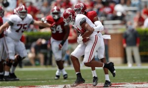 Traeshon Holden (No. 11) with a reception in Alabama's spring game