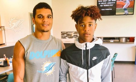 Earl Little Jr poses with Minkah Fitzpatrick