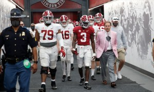 Nick Saban in his pink suit walking players out of tunnel for A-Day