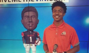 Alabama freshman WR JoJo Earle holding a bobble head of himself