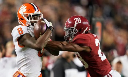 Justyn Ross (No. 8) makes a catch for Clemson versus Alabama's Josh Jobe in 2019 CFP National Championship Game