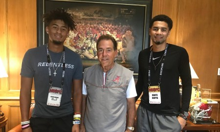 Devin Moore stands to the left of Nick Saban doing visit to Alabama