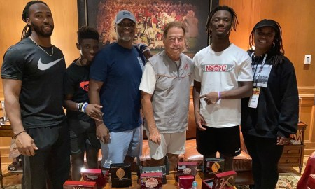 Makari Vickers poses for picture with Nick Saban and family during visit