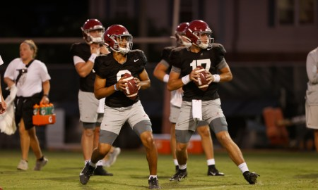 Bryce Young and Paul Tyson attempting passes in Alabama fall practice