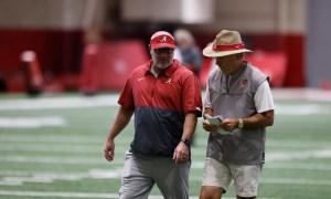 Nick Saban walks with Dr. Matt Rhea at Alabama practice