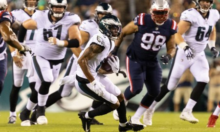 DeVonta Smith runs with the ball for Eagles versus Patriots