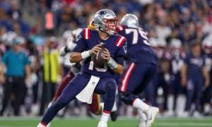 Mac Jones (No. 10) setting up to throw for Patriots in Thursday's NFL Preseason Game versus Washington