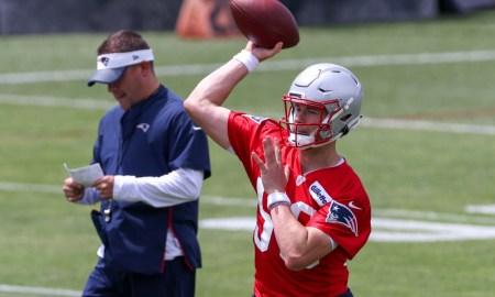 Mac Jones attempts a throw at Patriots OTAs with Josh McDaniels looking on