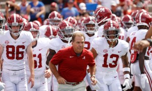 Nick Saban leads Tide players on the field versus Florida