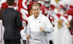 Nick Saban runs on the field at Bryant-Denny Stadium for Alabama versus Southern Mississippi game