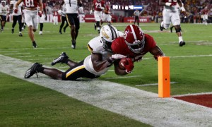 Roydell Williams (#23) stretches out inside the 1-yard line for Alabama versus USM