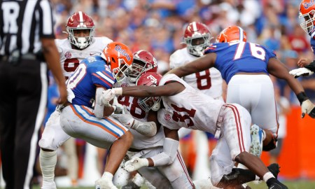 Will Anderson (#31) and Phidarian Mathis (#48) tackle a Florida running back