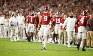 Bryce Young (#9) walks on the field for Alabama versus Tennessee after a timeout