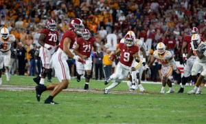 Bryce Young (#9) scrambling versus Tennessee during Alabama's homecoming game