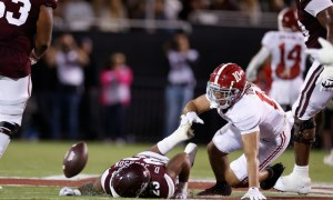 Alabama LB Henry To'oto'o (#10) tackles a running back for Mississippi State last week