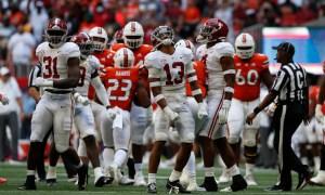 Malachi Moore (#13) celebrates an interception for Alabama vs. Miami
