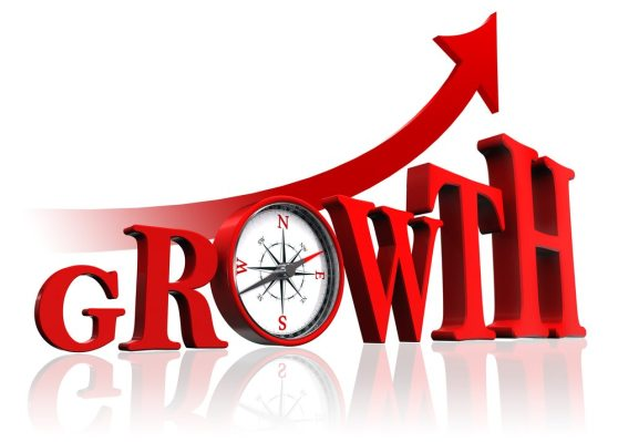 growth red word with compass and arrow