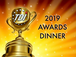 """Large gold trophy with TDI logo with a bright yellow and orange background with white stars. Text shown """"2019 TDI Awards Dinner"""""""