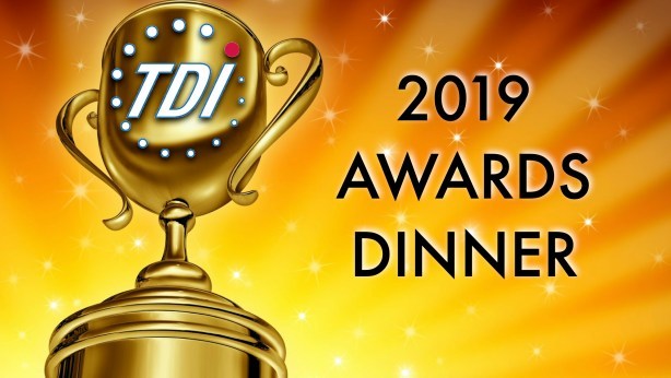 "Large gold trophy with TDI logo with a bright yellow and orange background with white stars. Text shown ""2019 TDI Awards Dinner"""