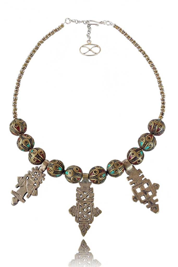Queen of Sheba Necklace - The queen regnant was a woman of great beauty, power and wealth – a fitting name for adornment that embodies chic opulence. Three featured Ethiopian Crosses are made from Maria Teresa Thaler coins, a common medium of trade for many centuries in the region. [Image: Courtesy of Shikhazuri]