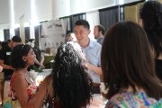 Andrew Ge, Account Executive, AOI Tea Company, explains products to the attendees.