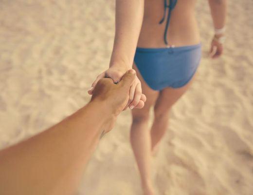 closer, beach, holding hands,mixed couple