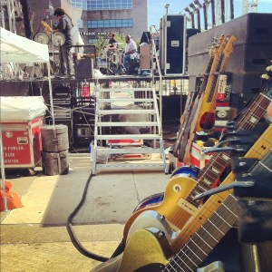 From backstage (a corner of the gold glittery guitar is in the foreground).