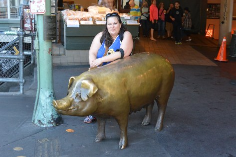 This is a really hard picture for me to post. Taken of me during my Seattle trip in August, it is a picture that isn't the controlled angles afforded me by a selfie. Instead, it is the photo I looked at and wondered if everyone passing by as it was taken, remarked that it is a photo of two piggies.