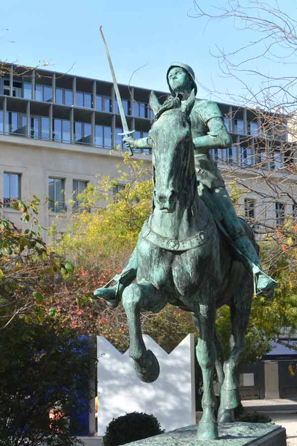 Woman and art. A statue of Joan of Arc riding a horse