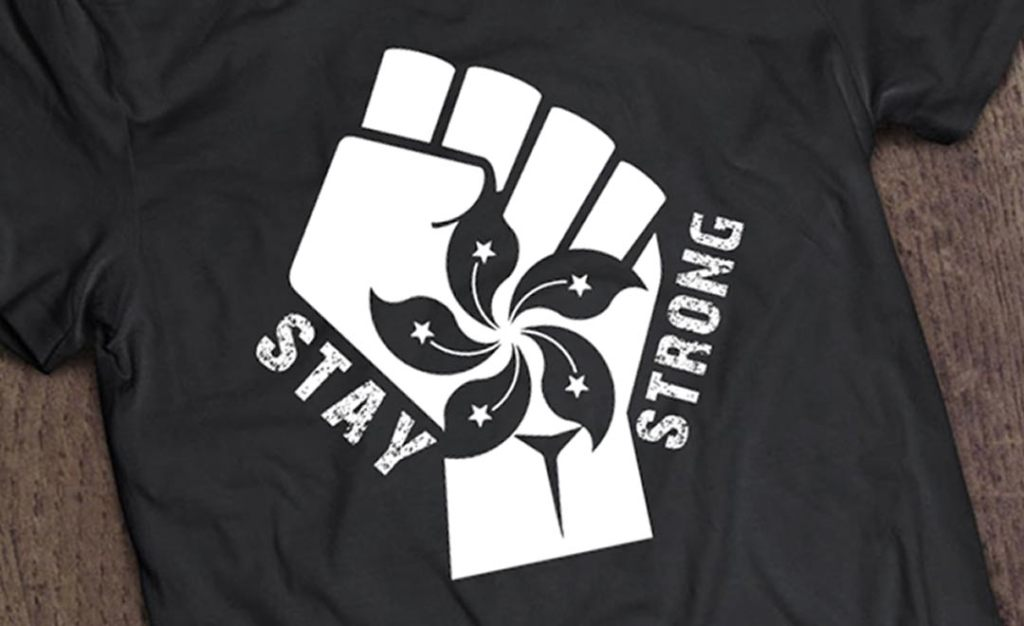 Stay strong Hong Kong on a black tshirt. Fist with flower from HK flag.