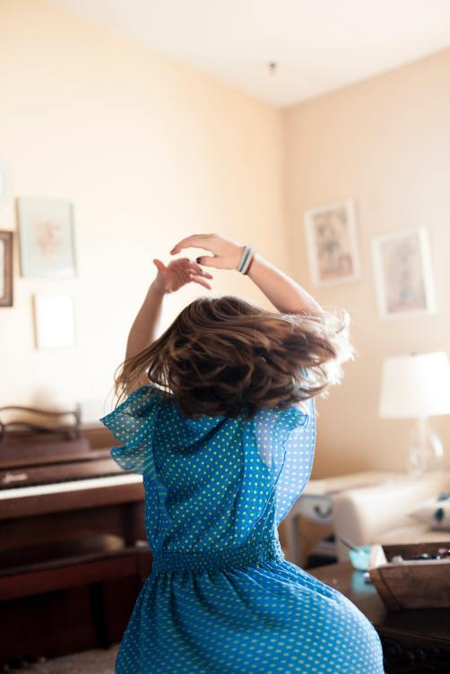 Little girl twirling in her living room