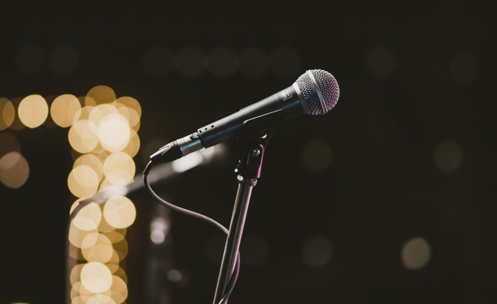 Close up on a microphone, ready for someone to step out of their comfort zone