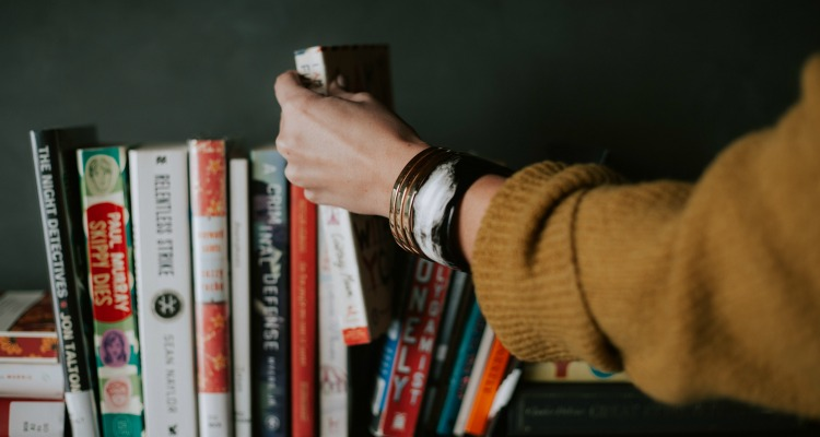 Choosing a book off a shelf