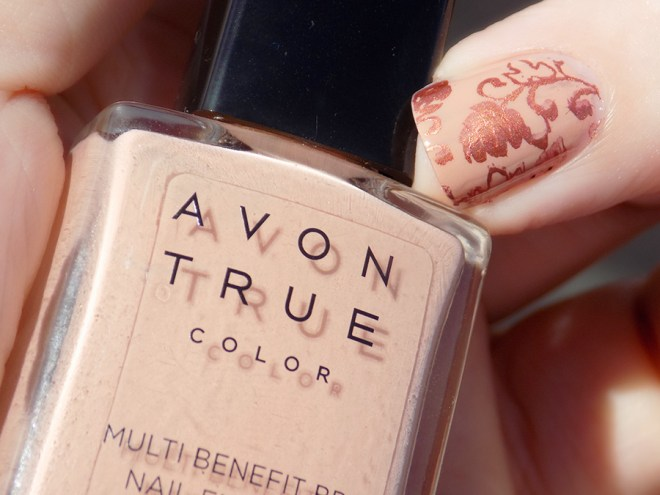 Avon True Color BB Nail Enamel Restoring Beige Stamped with MDU Copper in Sunlight Closeup