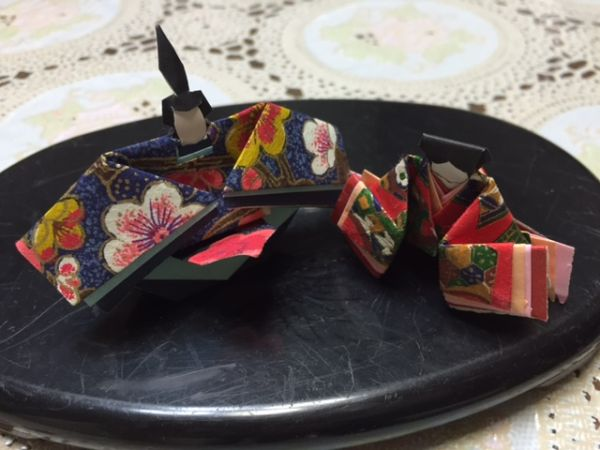 Hina dolls made of Origami paper and Japanese flower arrangement
