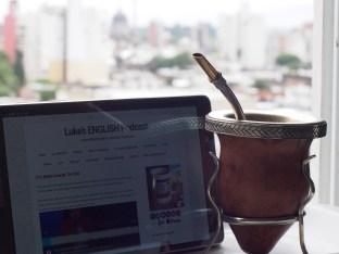 Maxi from San Nicolás, a small town of Argentina - with the view from his kitchen and a cup of mate (local tea)