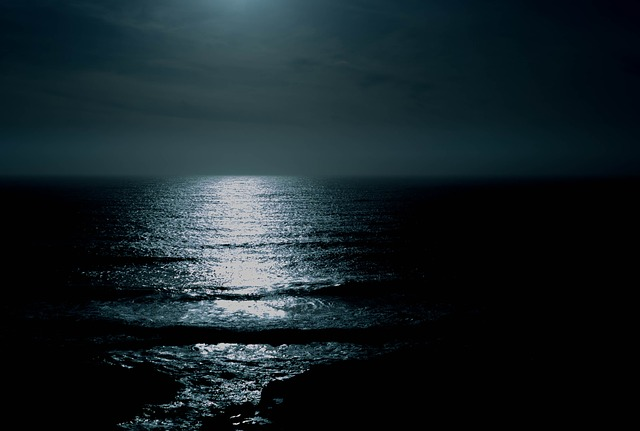 a moon over the ocean
