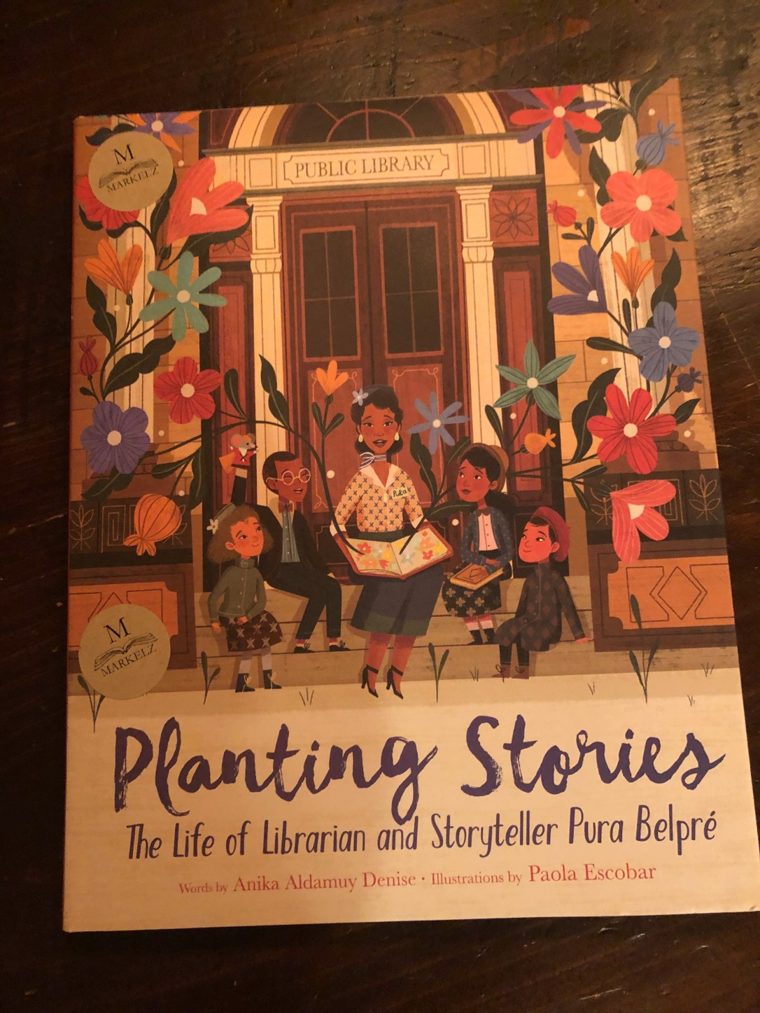 Planting Stories: The Life of Librarian and Storyteller Pura Belpré, by Anika Aldamuy Denise, illustrated by Paola Escobar